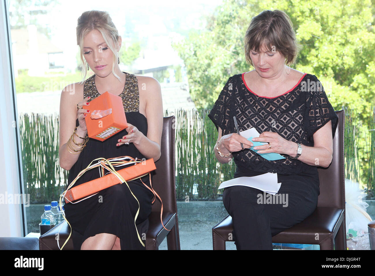 kristin cavallari opens gifts at her baby shower with her mother stock