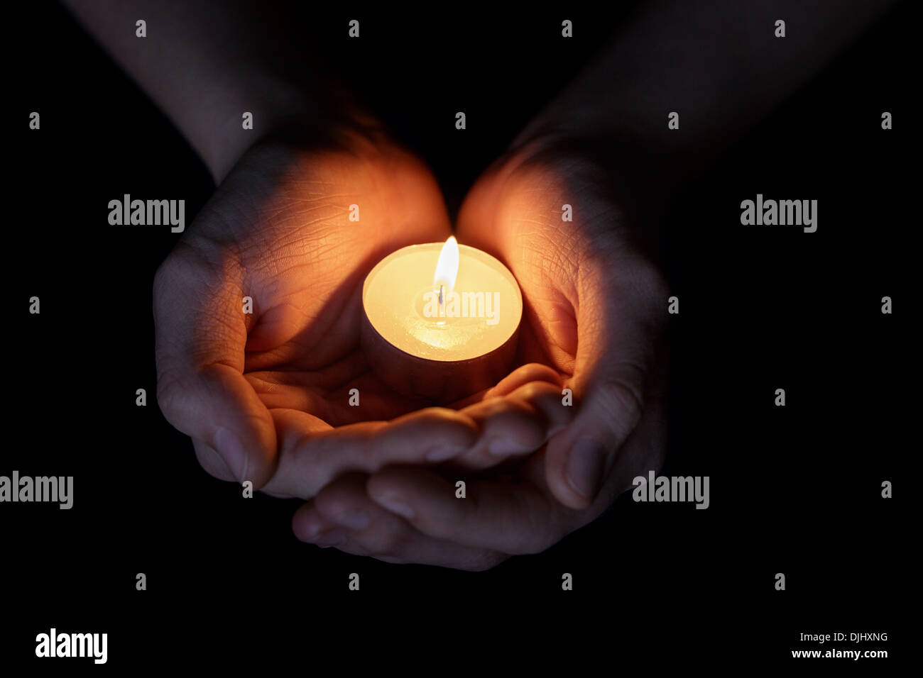 female teen hands holding burning candle in the dark Stock Photo ... for Holding Candle In The Dark  181pct