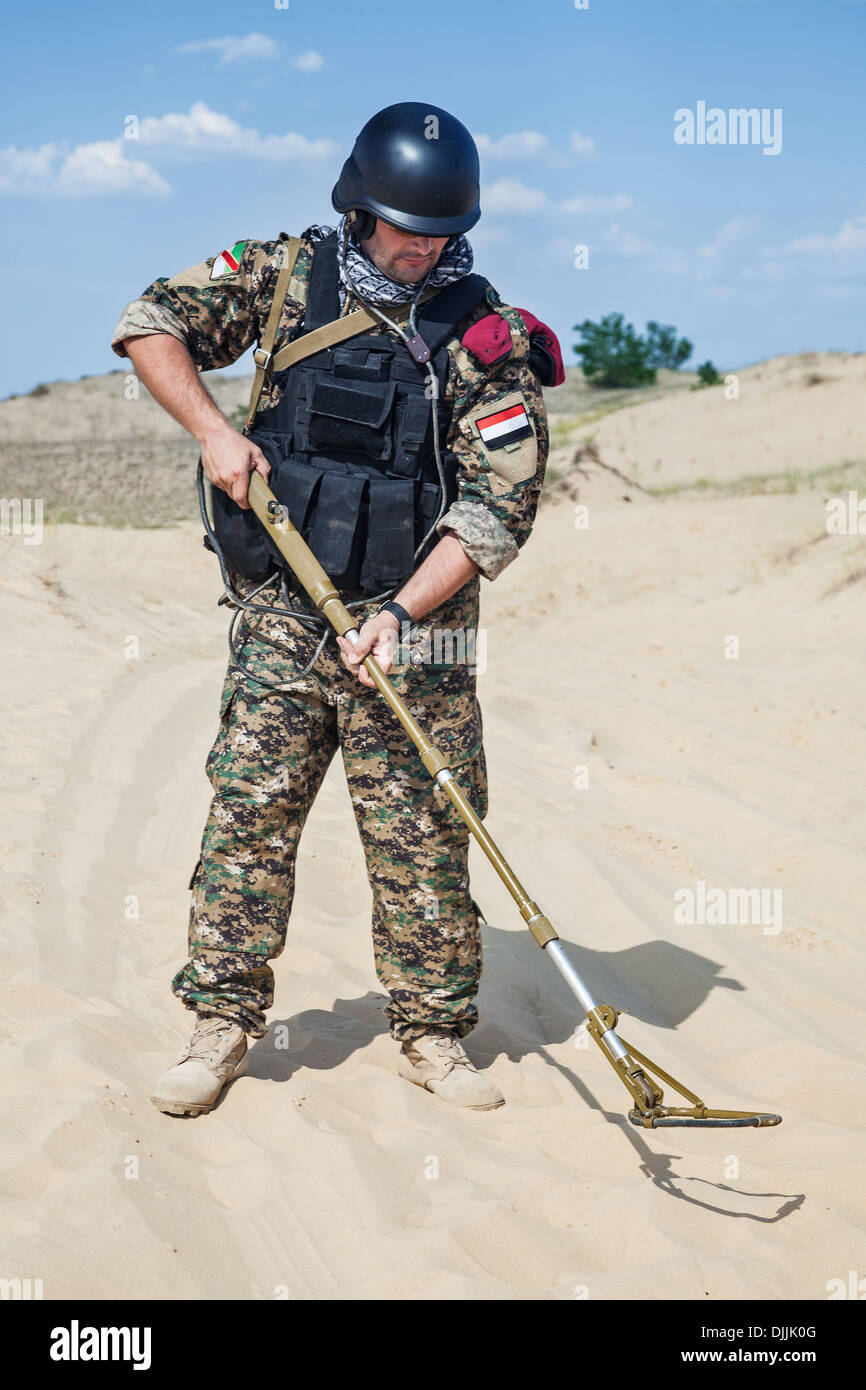 Jew Detector: Soldier With Metal Detector Stock Photo, Royalty Free