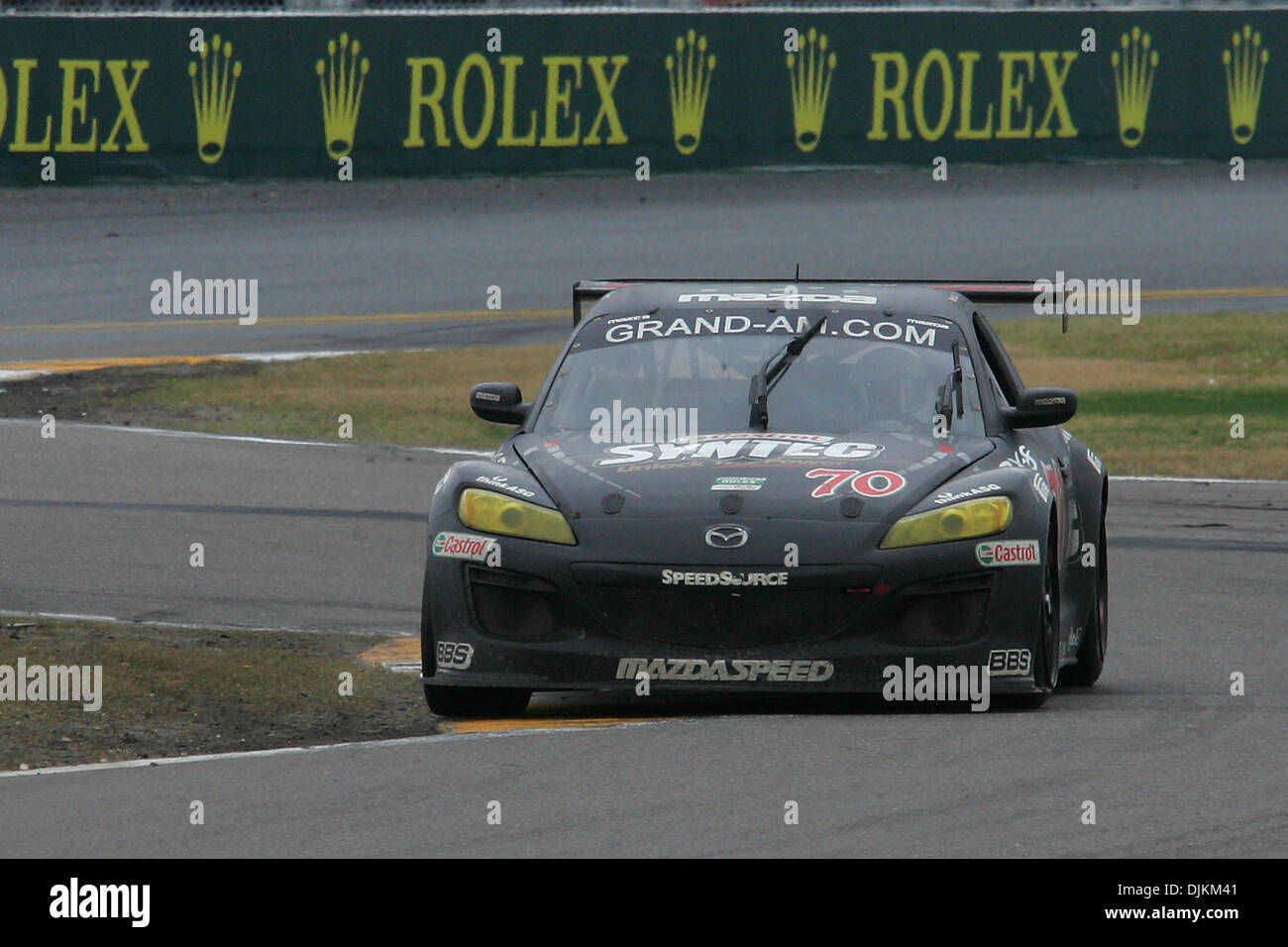The No. 70 Mazda RX-8, GT class winner, races through the chicane ...