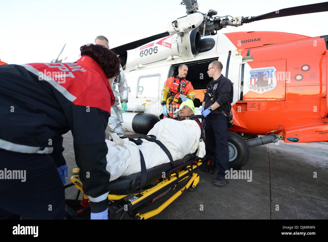 Crew transfer stock photos crew transfer stock images alamy a coast guard mh 60 jayhawk helicopter crew transfers an injured man to a kodiak publicscrutiny Images