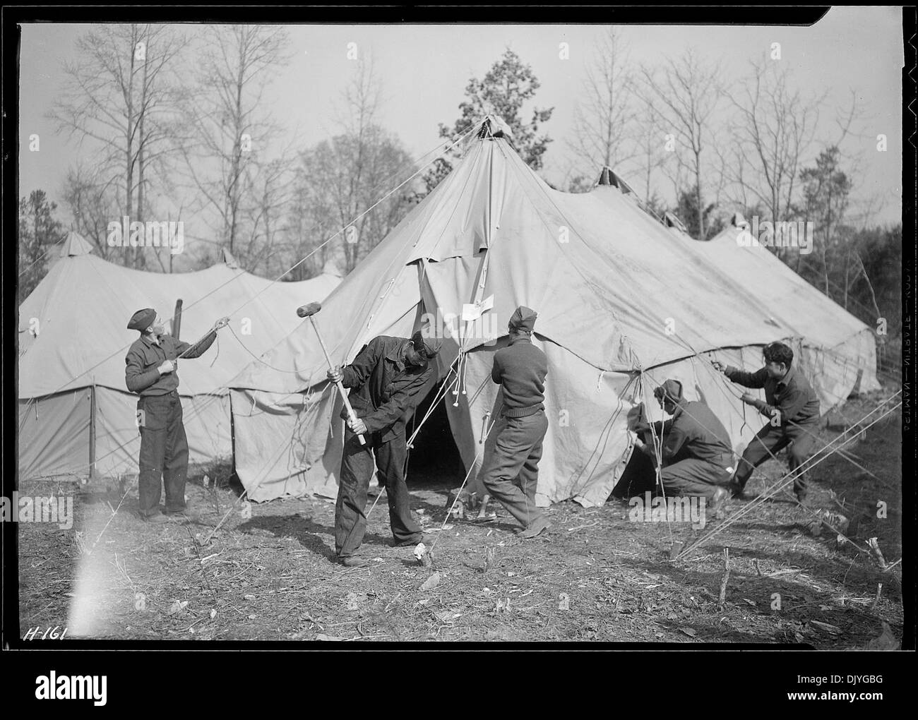 Setting up a sleeping tent at CCC C& TVA 5E22 near Esco Tennessee to accommodate replacements who arrived from... 532779 : tennessee tent - memphite.com