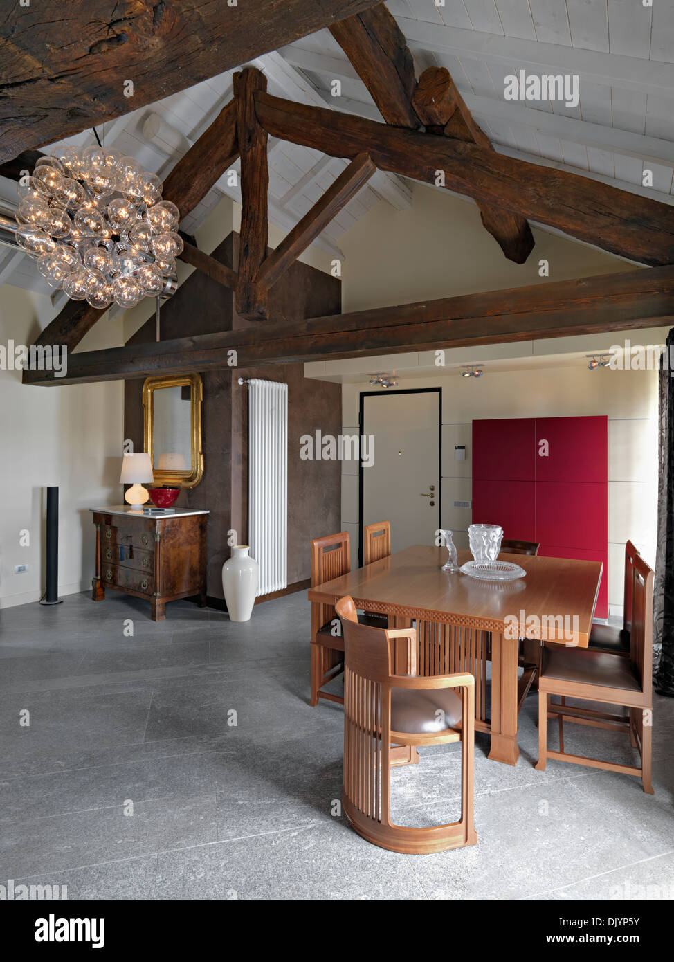 Luxurious Dining Table Near To Entrance Of A Attic With Trussed Roof And Ancient Chest Drawers