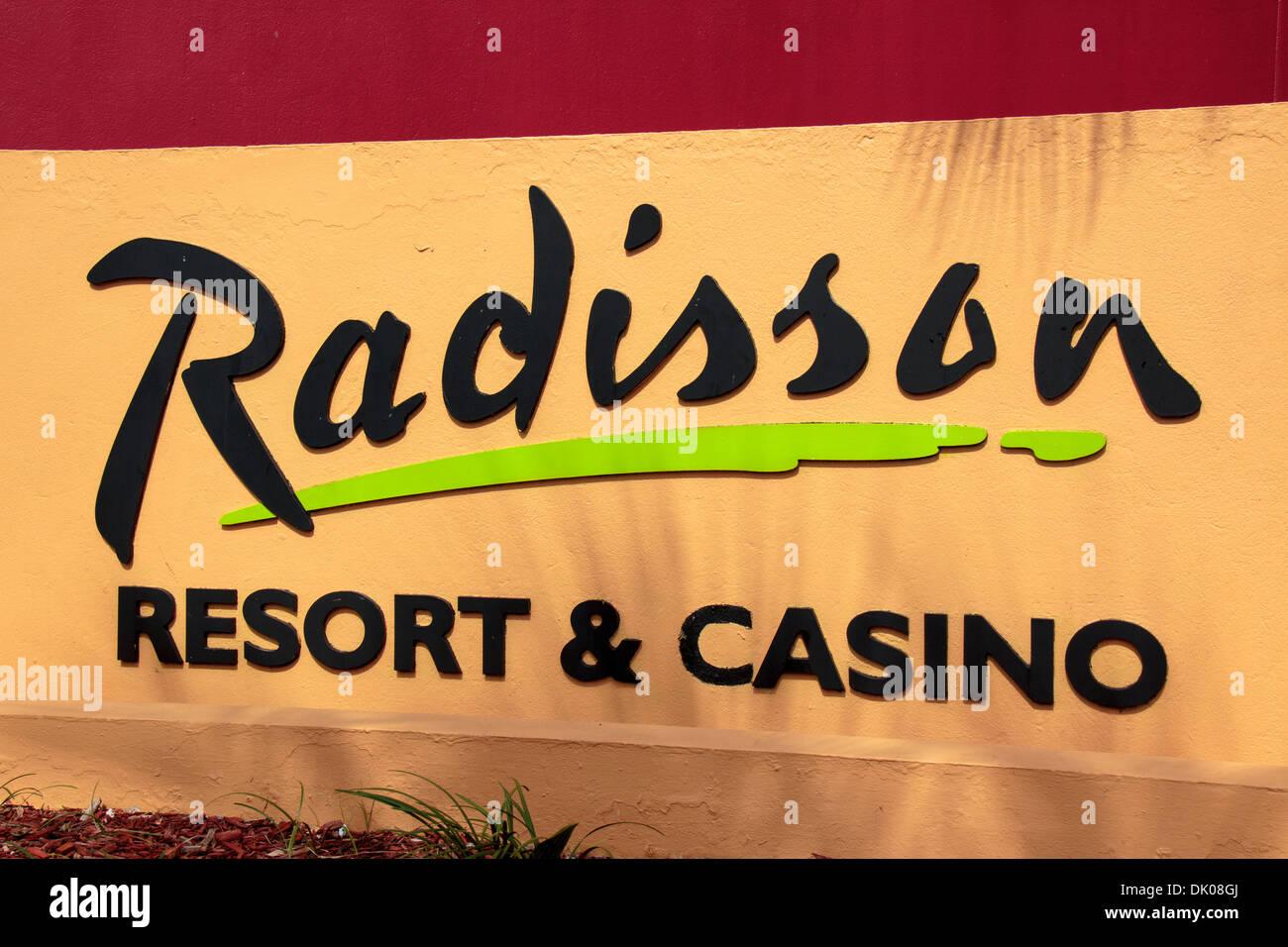 sign for the radisson aruba resort casino & spa entrance from palm