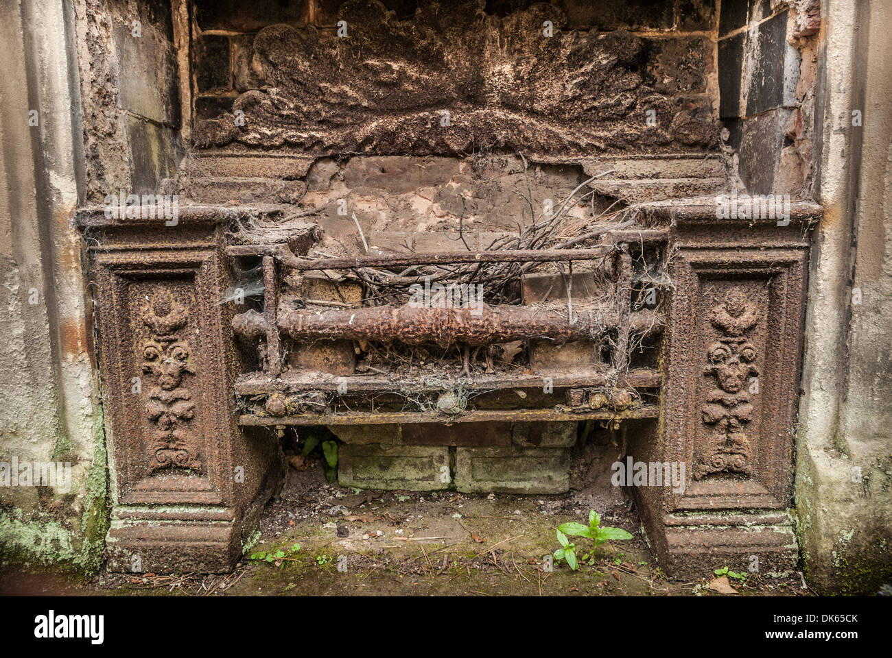 old cast iron fireplace rusty and abandoned stock photo royalty