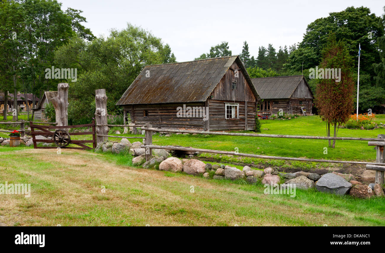 Farm houses with large green garden and timber and cobble stone yard ...