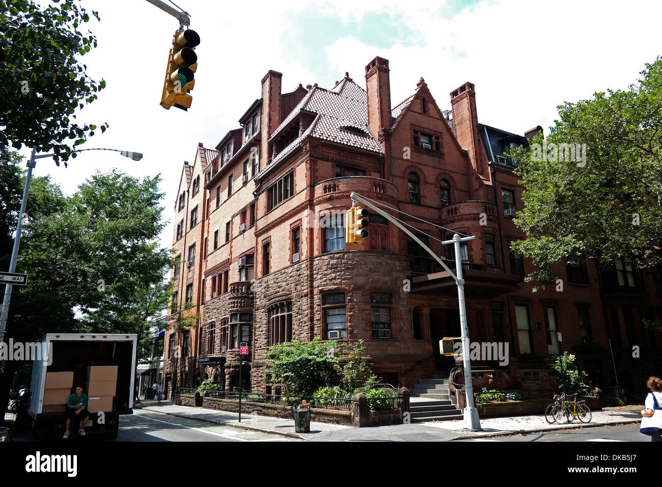Exterior view of a large traditional brownstone house in for New york city brownstone for sale