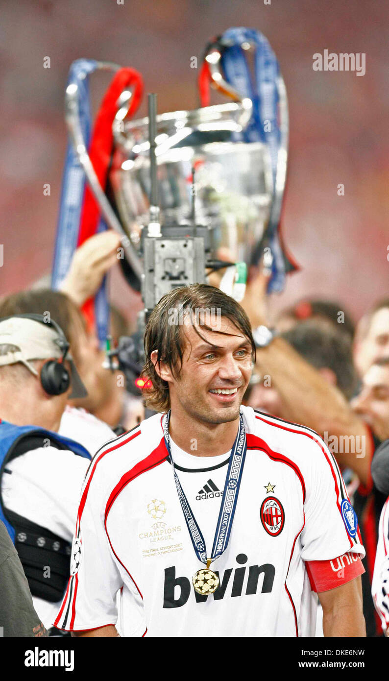 AC Milan s captain Paolo Maldini smiles as the European Cup is