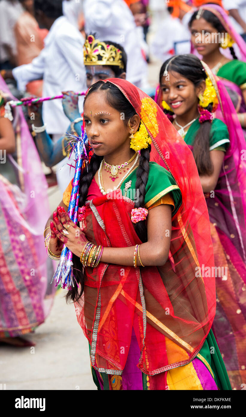 indian girls in traditional dress dancing at a festival in