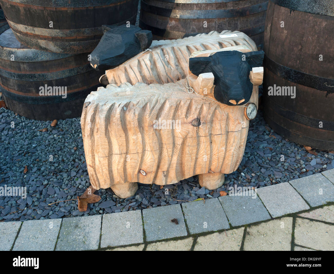 Near life sized carved wooden sheep garden ornaments stock photo royalty free image 63668627 - Wooden garden ornaments ...