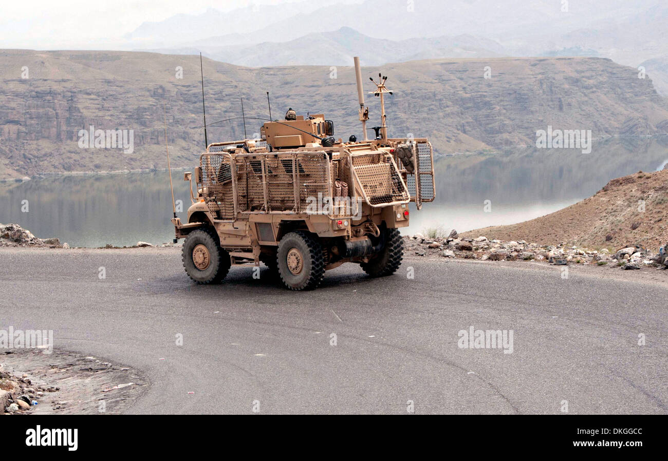 A US Army mine-resistant, ambush-protected vehicle travels ...