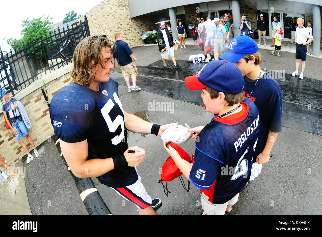 Buffalo Bills linebacker Paul Posluszny signs for some fans after