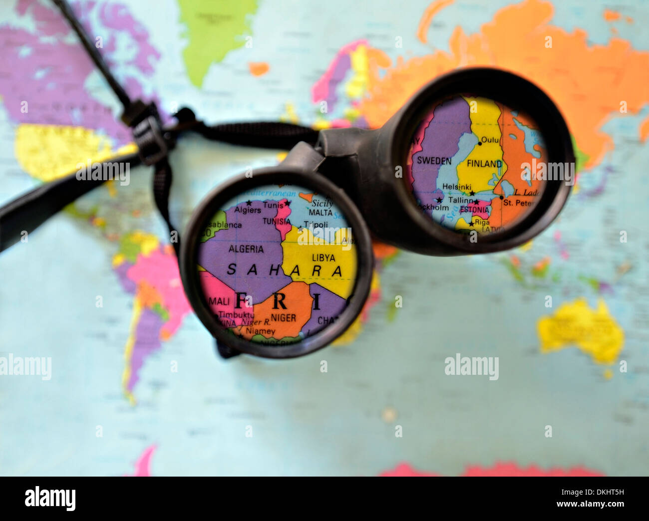 There is a global map of world finland stock photo royalty free a pair of binoculars on top of a world map countries highlighted in the lens gumiabroncs Image collections
