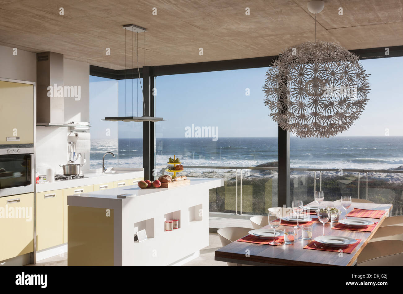 Kitchen And Dining Room In Modern House Overlooking Ocean