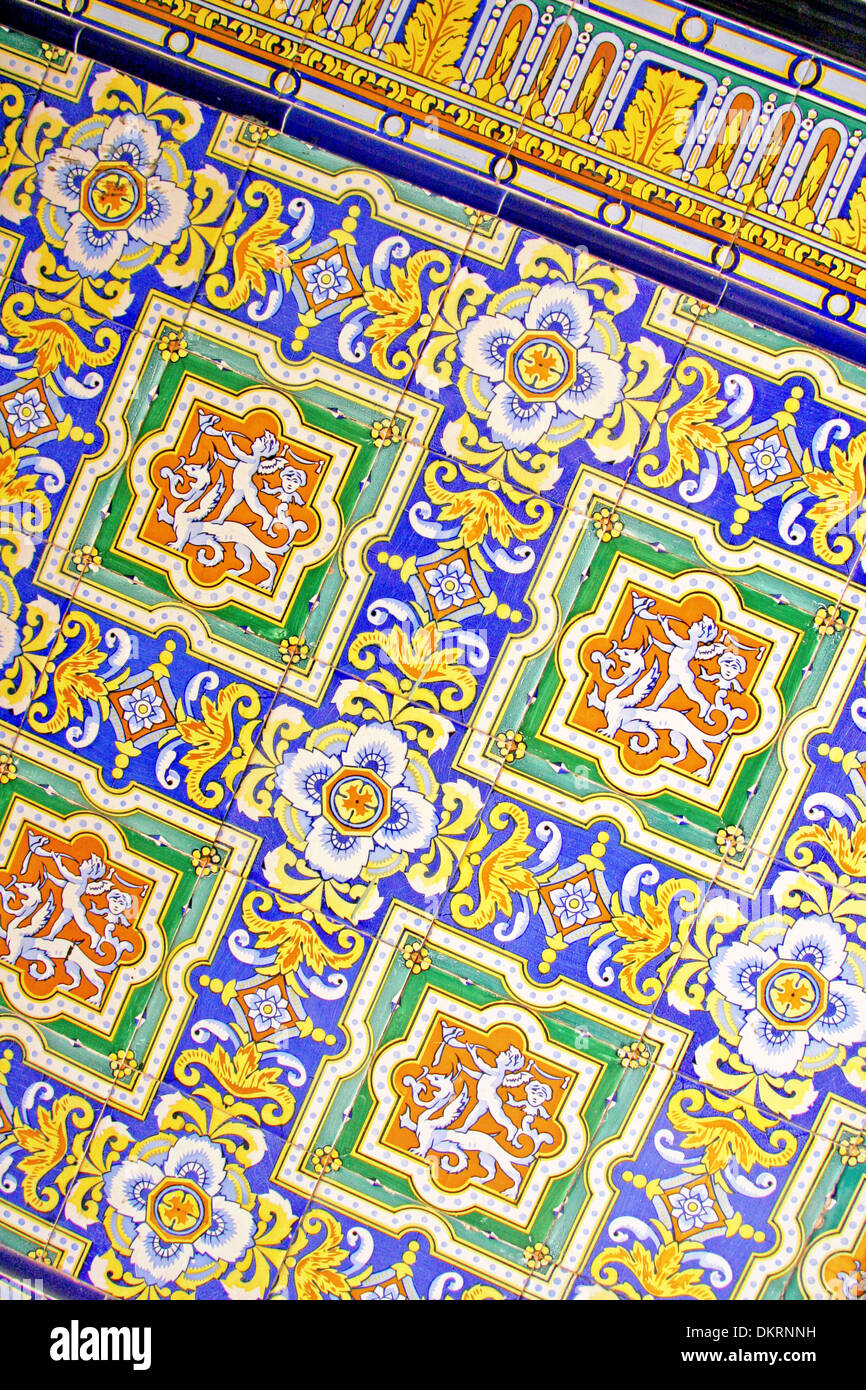 Close up of traditional spanish ornate ceramic wall tiles multi close up of traditional spanish ornate ceramic wall tiles multi coloured with yellows blues oranges malaga spain dailygadgetfo Images
