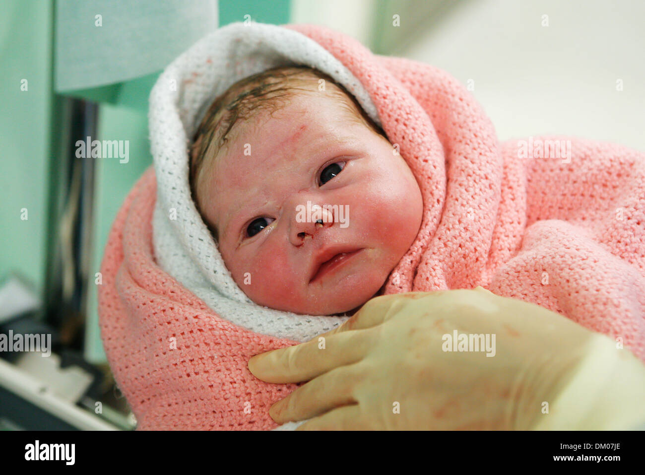 A Newborn Baby Moments After Birth Wrapped In Hospital