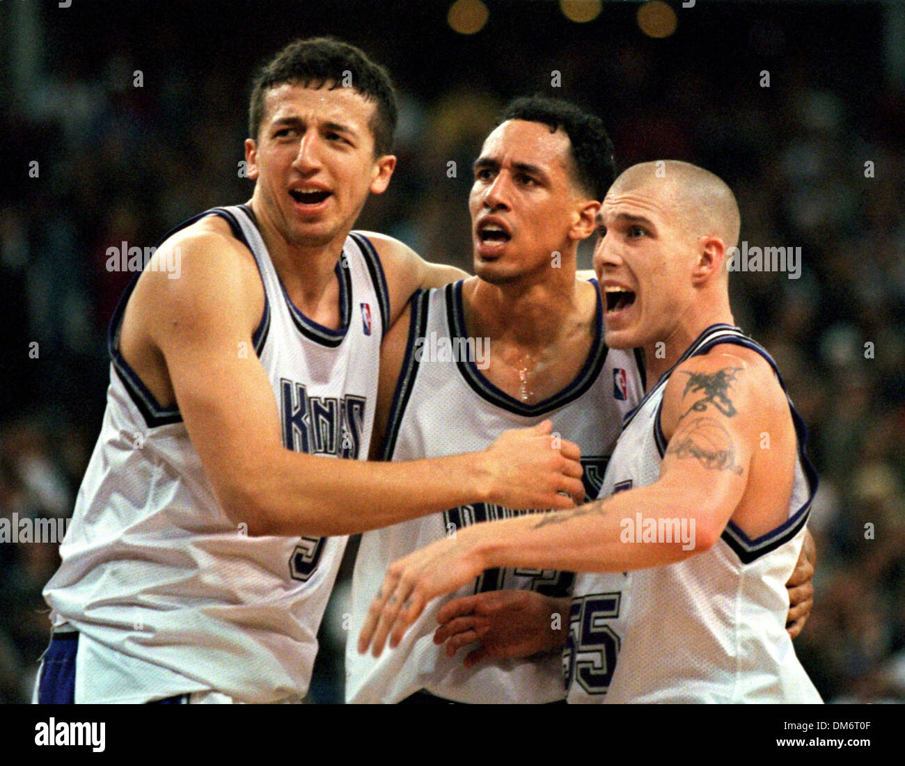 Celebrating Kings players Hedo Turkoglu Doug Christie and Jason