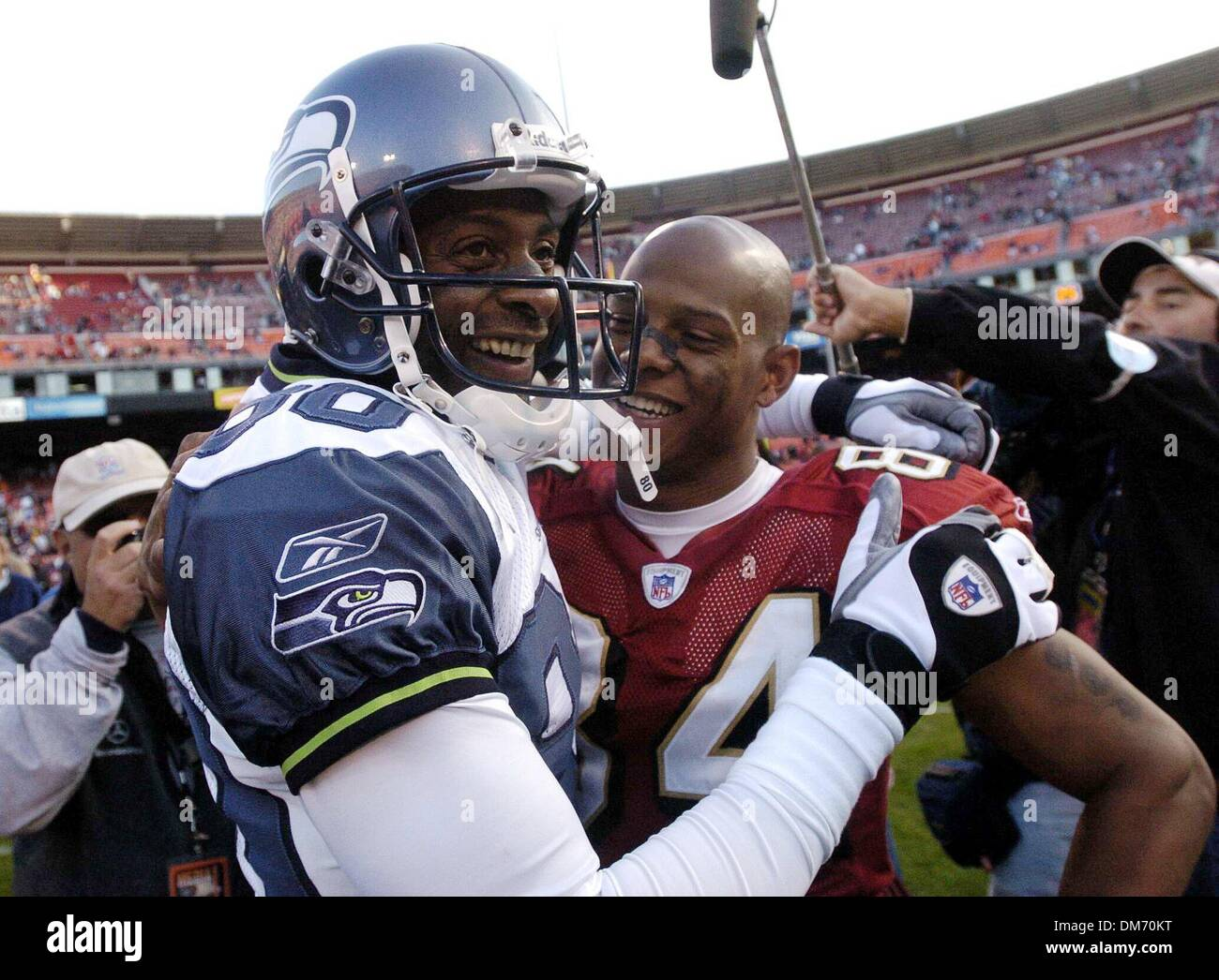 ... a touchdown Seattle Seahawks San Francisco 49ers Cedrick Wilson hugs Seattle  Seahawk Jerry Rice at Monster Park Sunday November 7 ... a1eb682c4