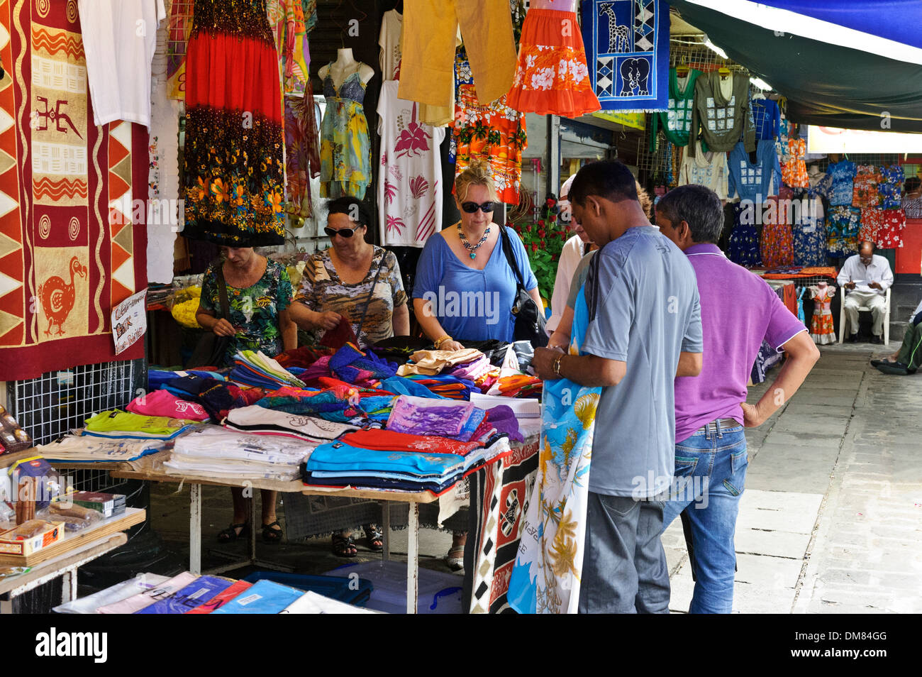 Tourists examining local crafts on sale in port louis market stock photo royalty free image - Mauritius market port louis ...