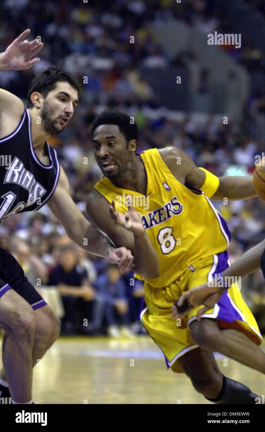 Laker Kobe Bryant drives against Peja Stojakovic in game 1 of the