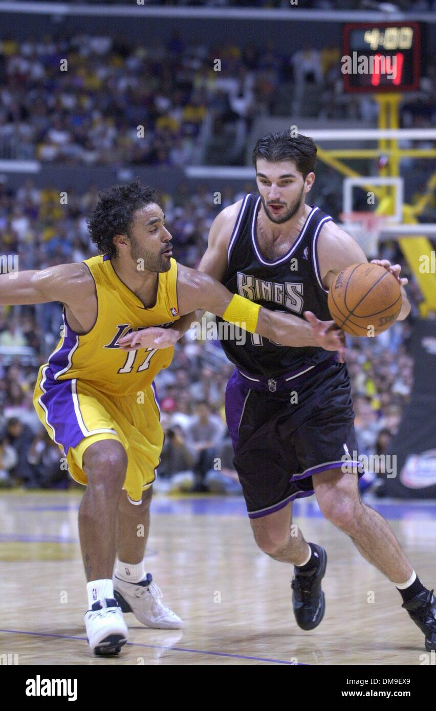 Peja Stojakovic drives againts Rick Fox in game 1 of the Western