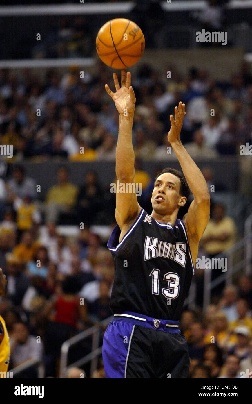 Doug Christie drops in a basket in the first quarter in game three