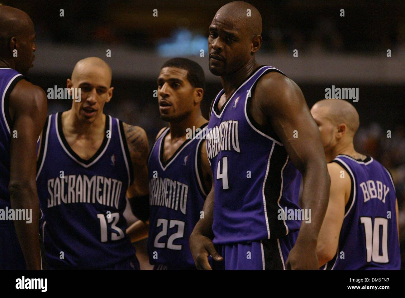 Dissappointment shows on the face of Chris Webber as Keon Clark