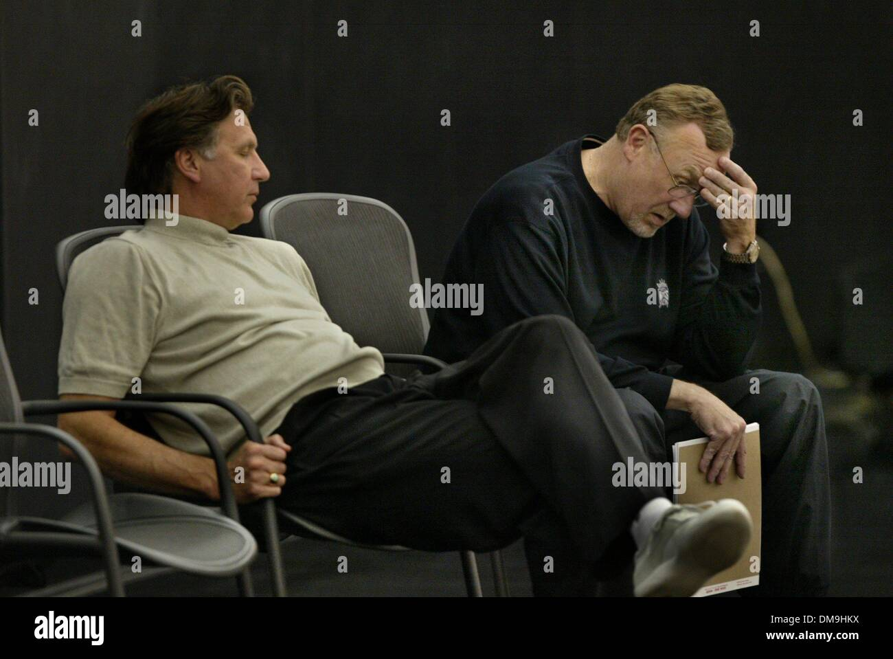 Rick Adelman and Geoff Petrie left sit down after a practice
