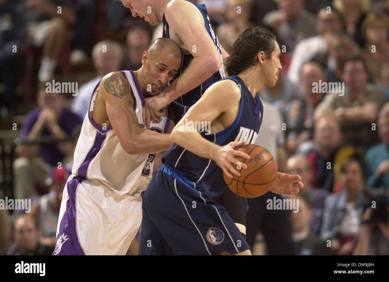 The Sacramento Kings Doug Christie is stopped by Shawn Bradley of