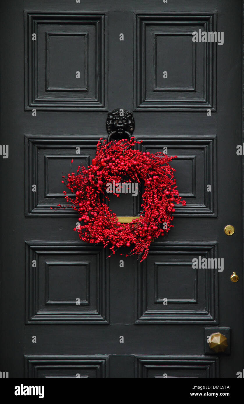 Christmas Wreath Hanging On Front Door Of Traditional English Country Home,  Ashford In The Water, Peak District, Derbyshire
