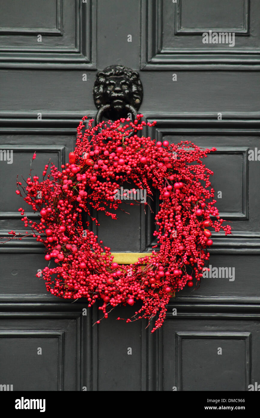 Christmas Wreath Hanging On Front Door Of Traditional English Country Home,  Peak District, Derbyshire