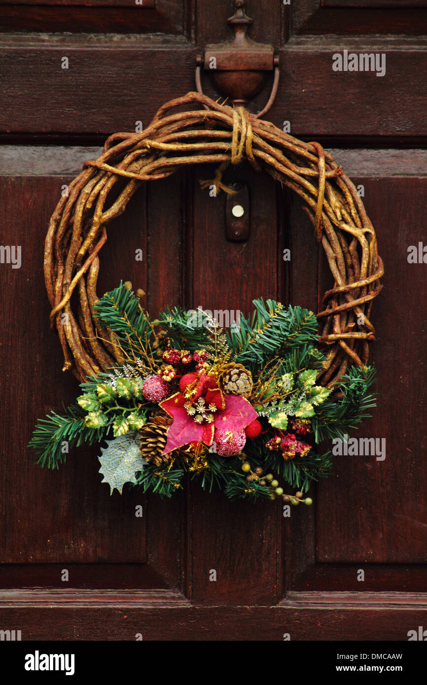 wreath hanging on front door of traditional stock photo royalty free image