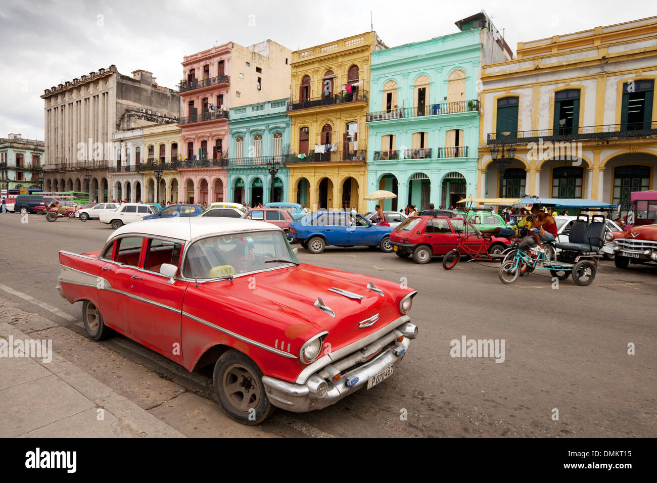 Old American Cars On The Street In Front Of Colorful