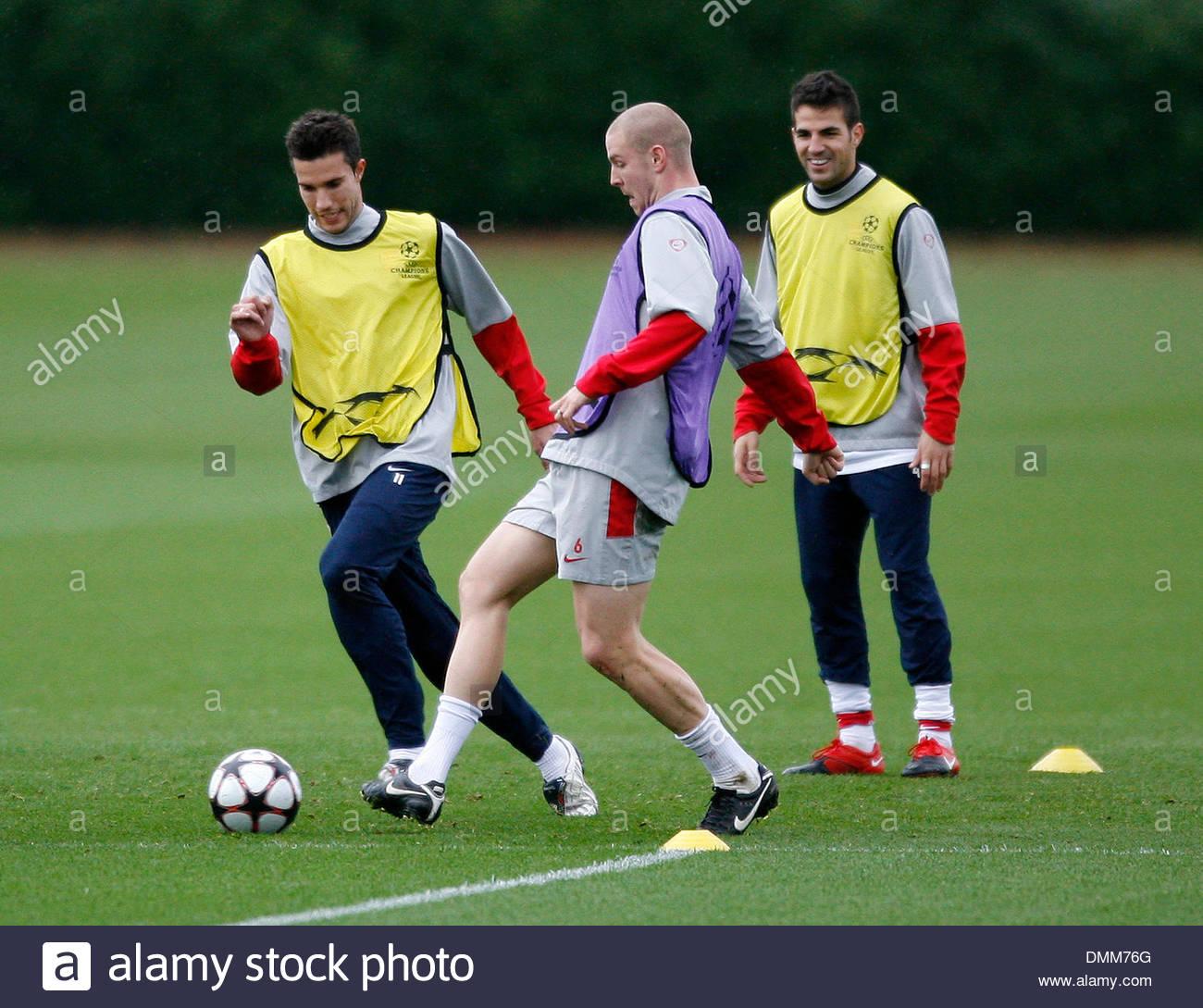 Arsenal s Robin Van Persie tussles with Philippe Senderos during