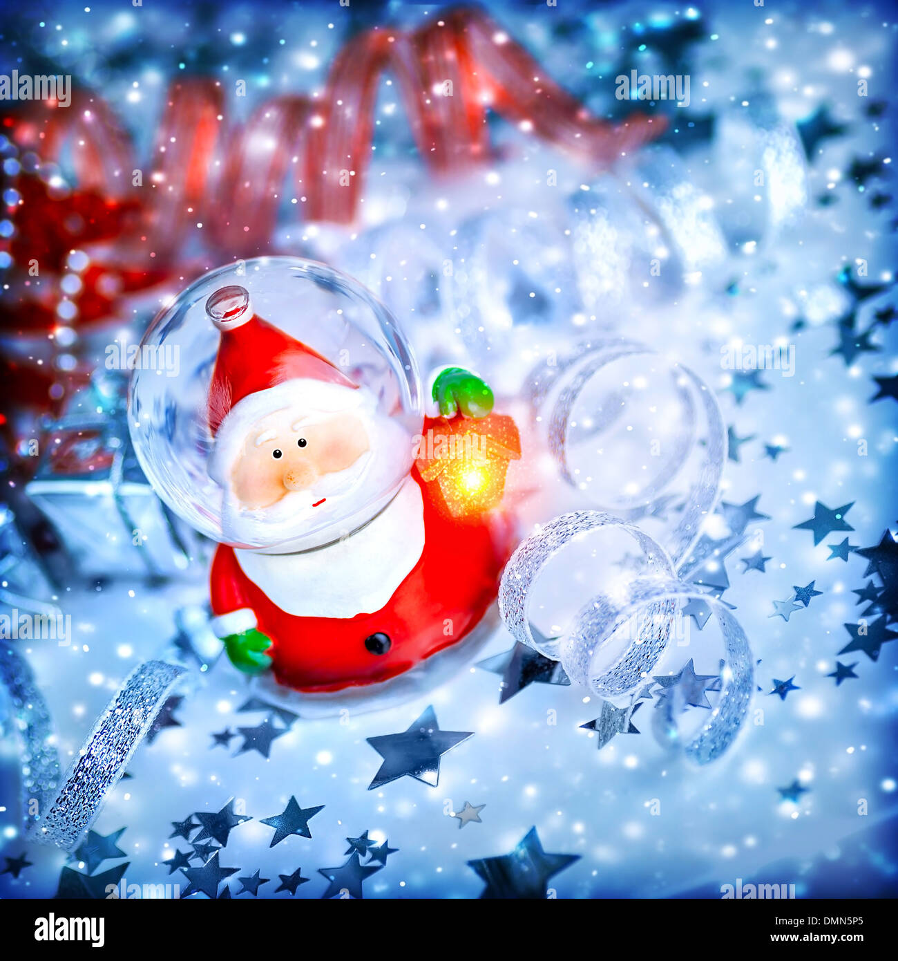 Blue christmas background with cute snow globe santa claus over blue christmas background with cute snow globe santa claus over stars magic of christmas eve and winter holidays m4hsunfo Images