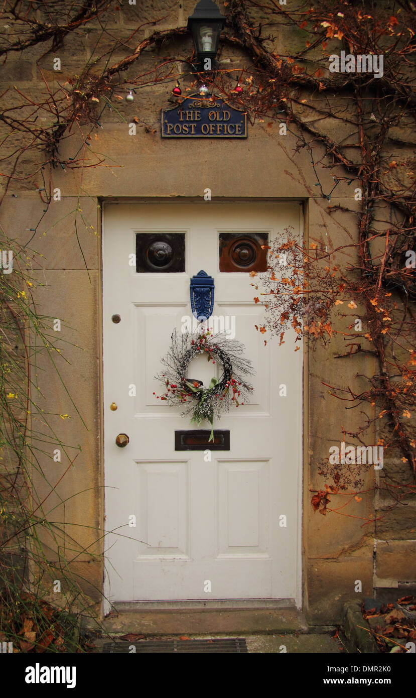 Christmas Wreath Hanging On Front Door Of Traditional English Country  Cottage, Eyam, Peak District