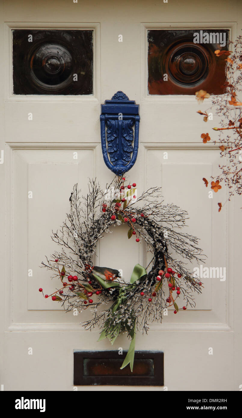 Christmas Wreath Hanging On Front Door Of Traditional English Country Stock Photo Royalty Free