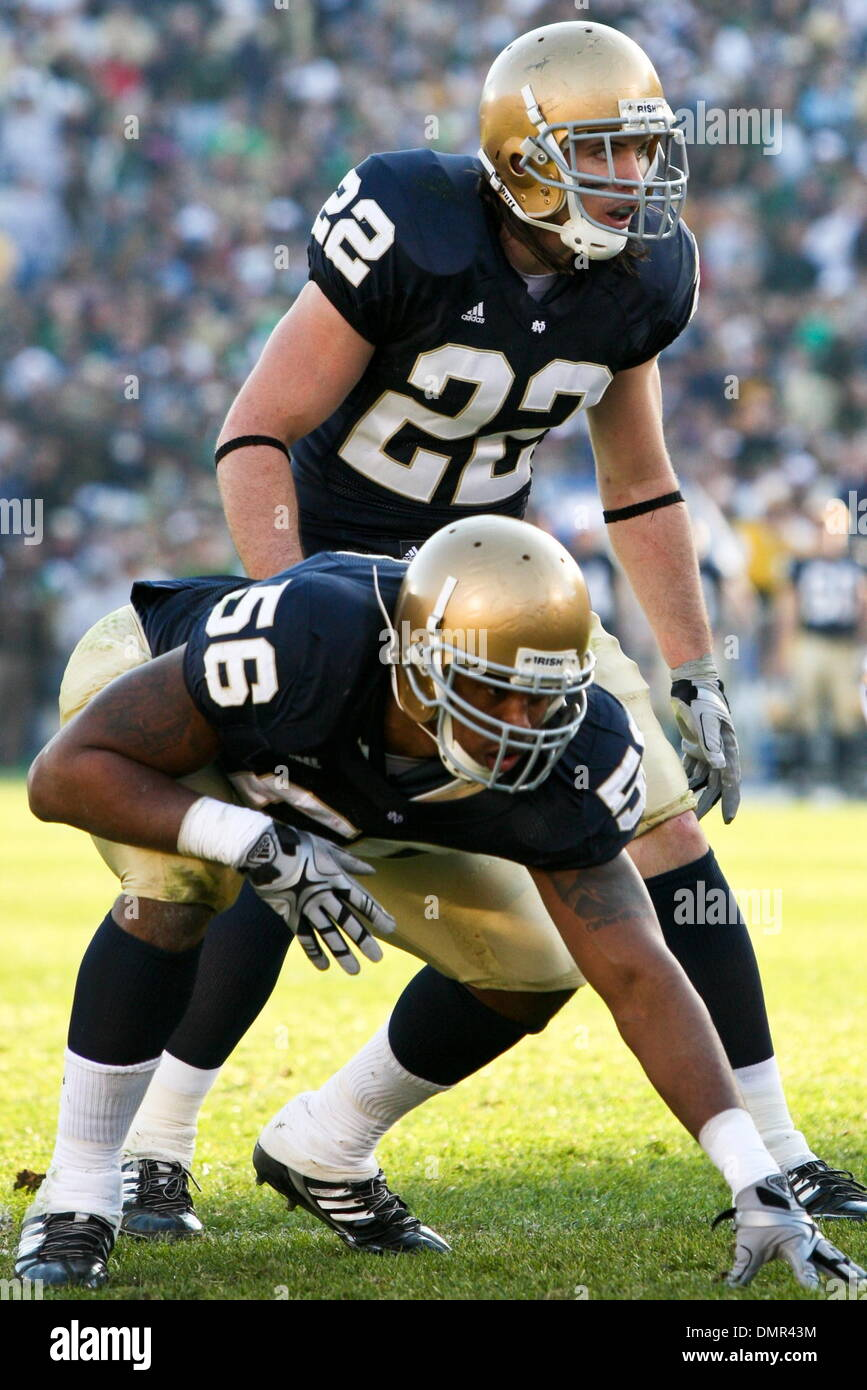 Notre Dame safety Harrison Smith 22 and defensive end Kerry Neal
