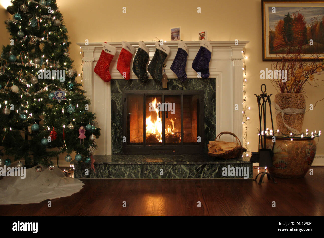 stockings hung over the fireplace during christmas stock photo