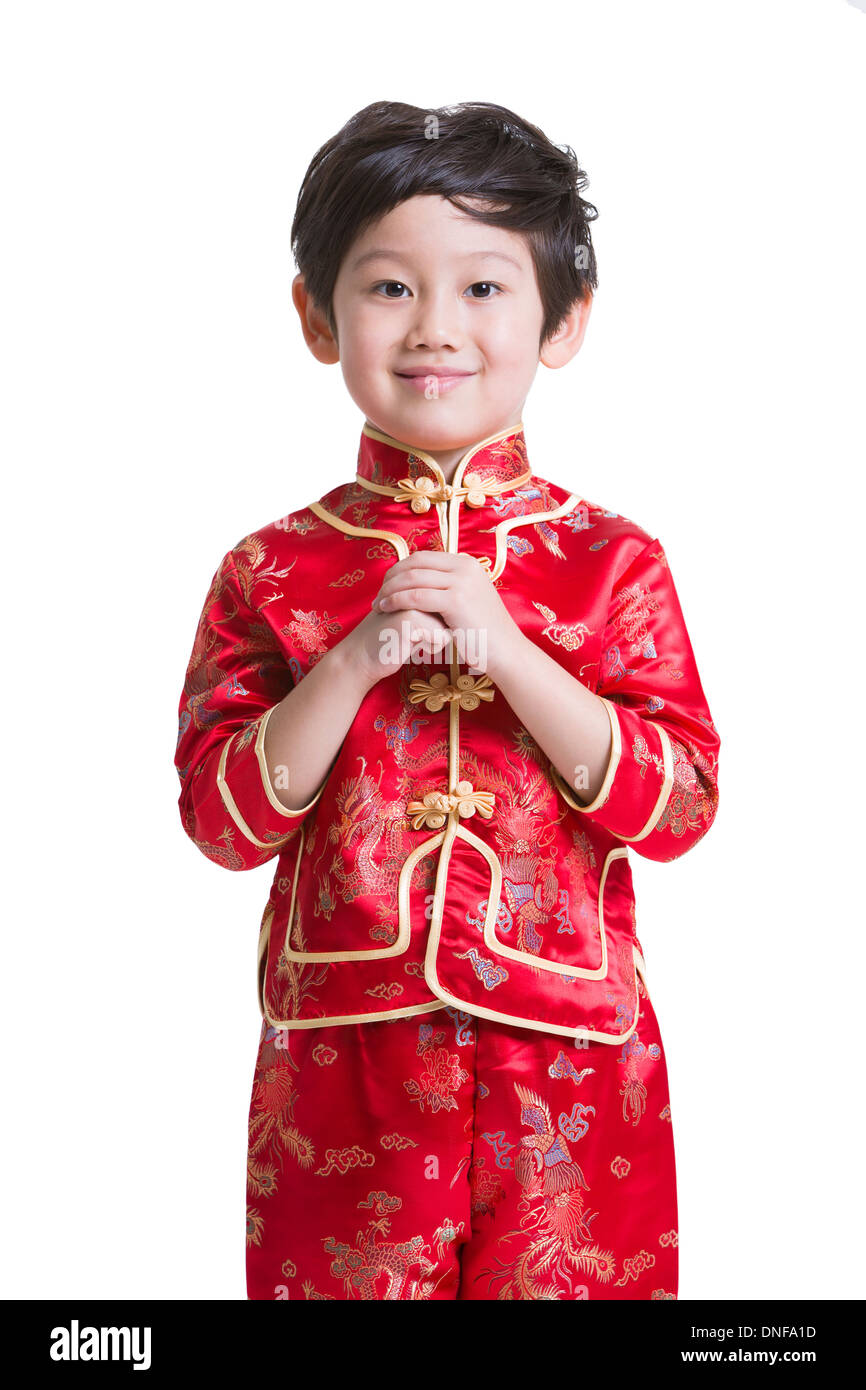 cute boy in traditional clothing greeting for chinese new year stock photo royalty free image. Black Bedroom Furniture Sets. Home Design Ideas