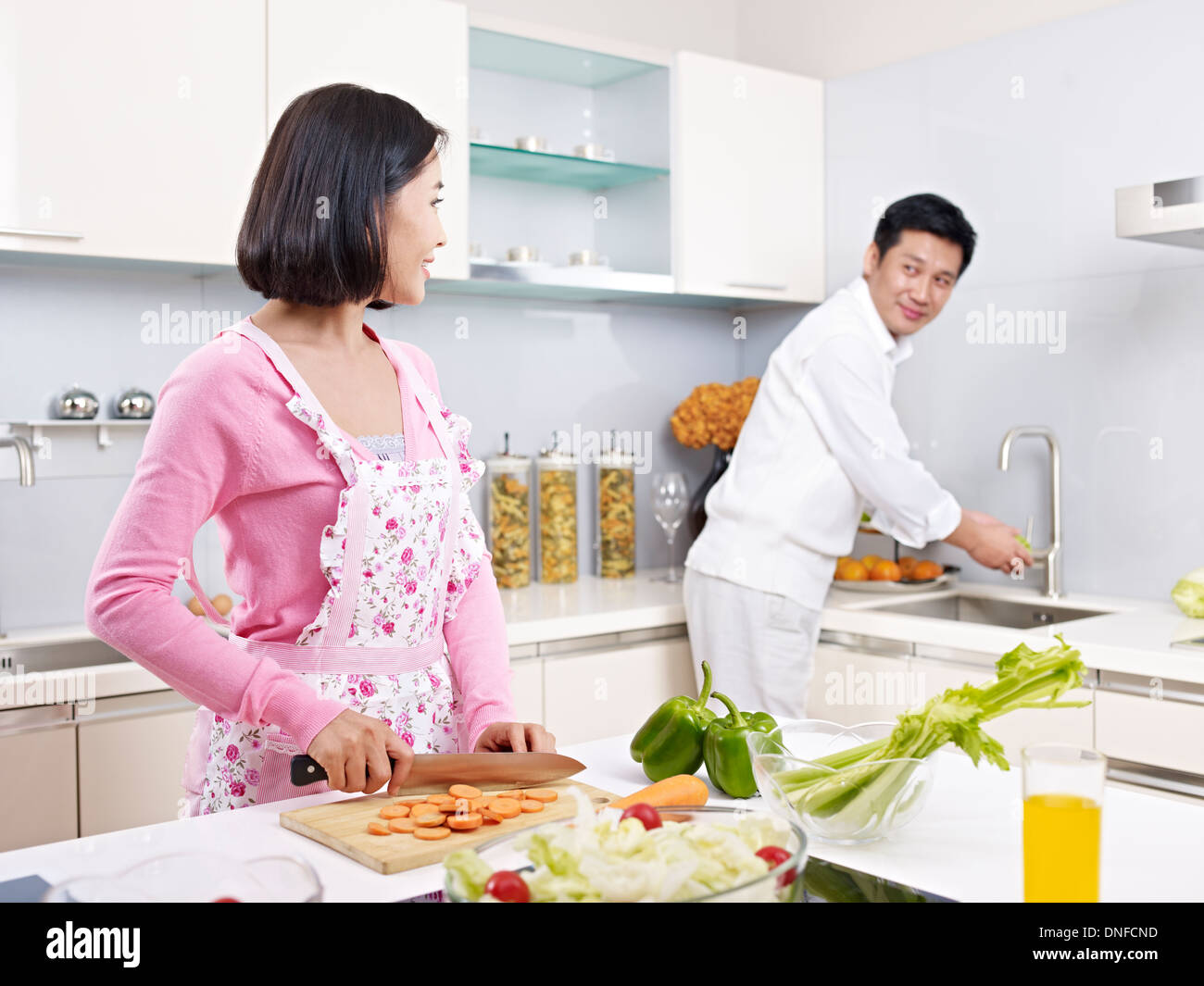 Loving asian couple in kitchen stock photo royalty free for Xnxx in the kitchen