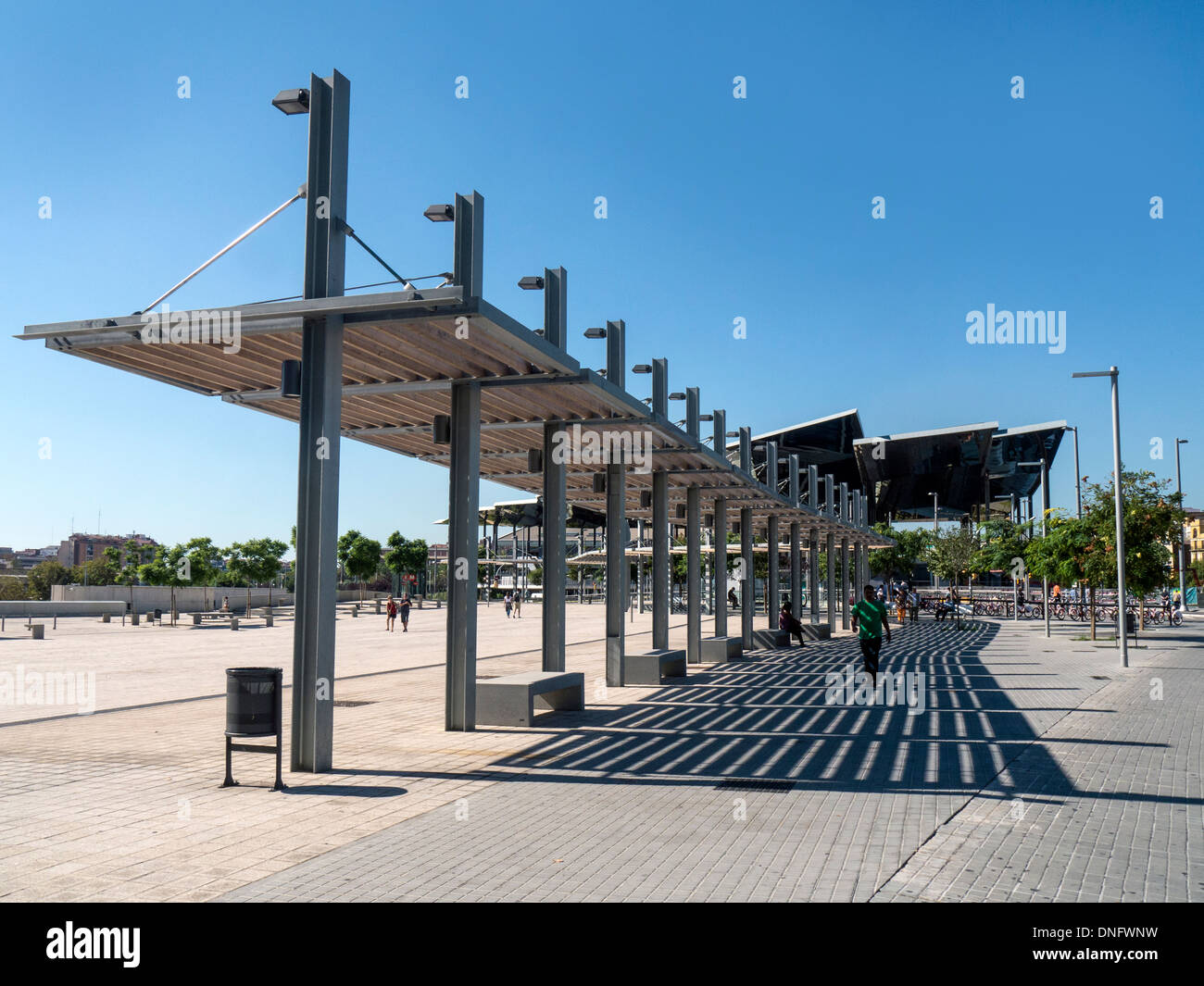 shaded walkway from the design museum disseny hub to glories tram station in the glories area of barcelona spain