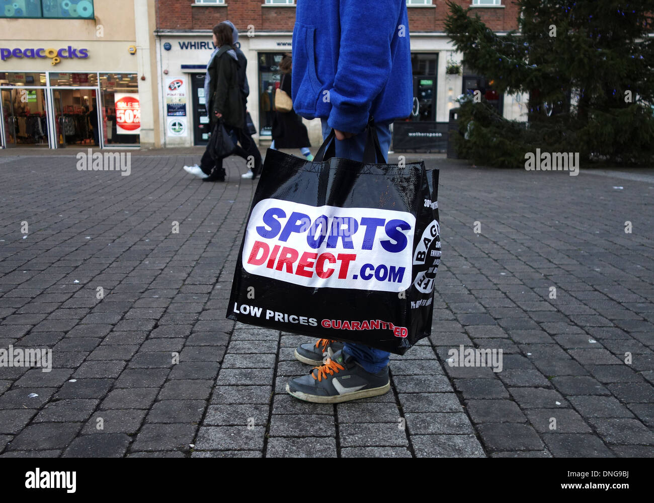 a customer carrying a sports direct shopping bag Stock Photo ...