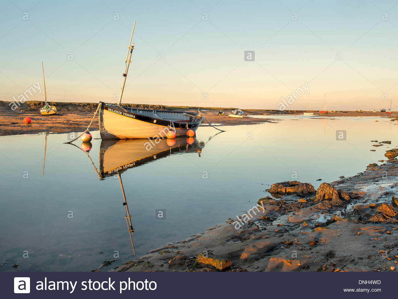 A fishing boat is moored during low tide on the north for Tides 4 fishing skyway