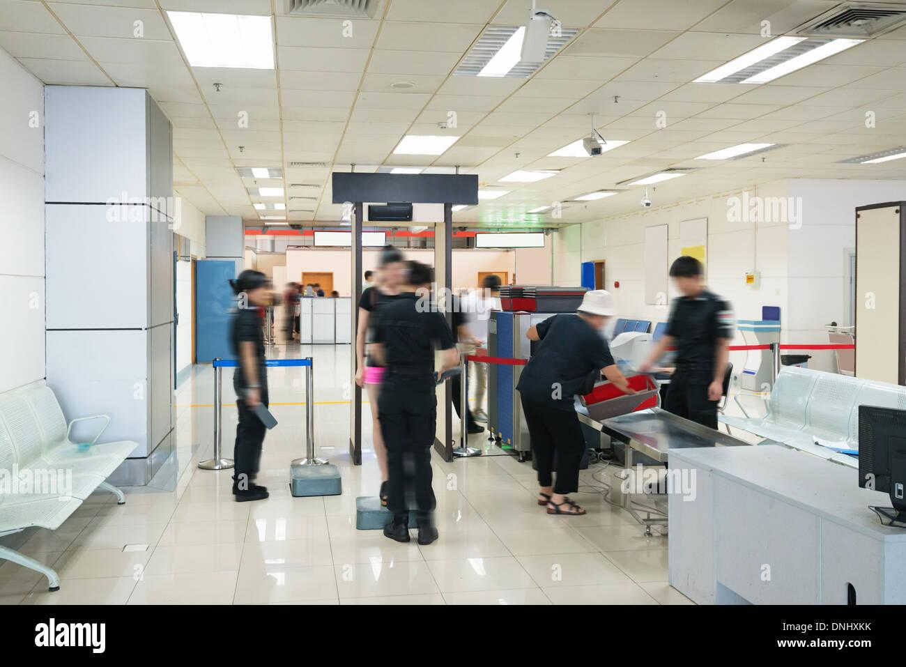 Security metal detector school - Airport Security Check With Passenger Walking Through Metal Detector Stock Image