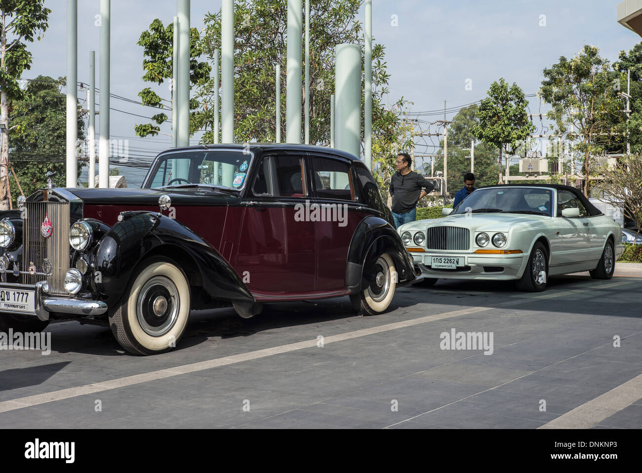 Stock photo vintage 1951 rolls royce silver dawn and modern bentley azure providing an interesting example of executive vehicle evolution