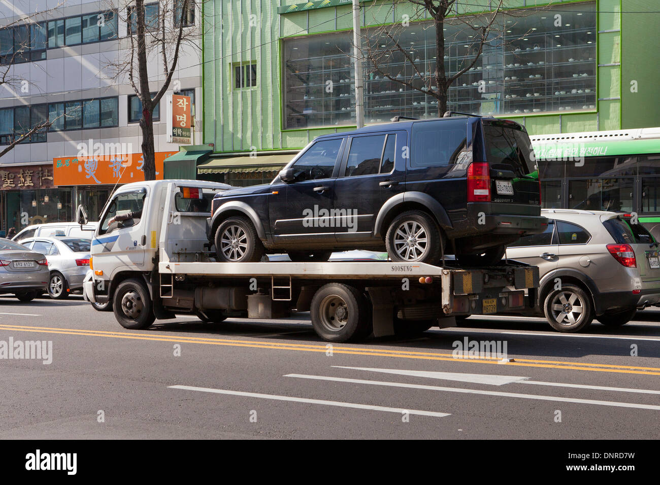 Car on flatbed tow truck seoul south korea stock image