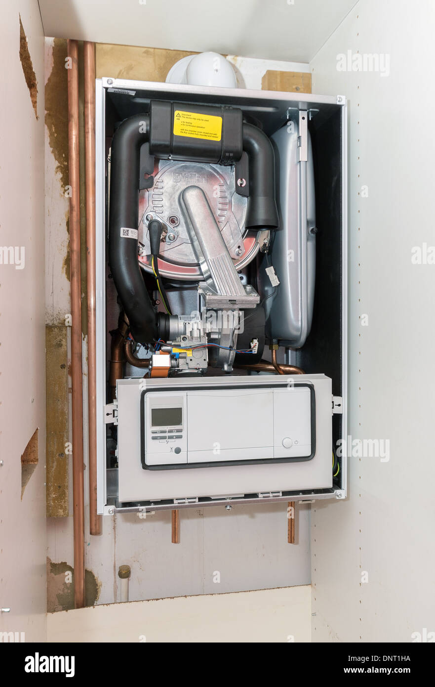 The installation of a vaillant ecotec pro 28 combination for Kitchen boiler cupboard