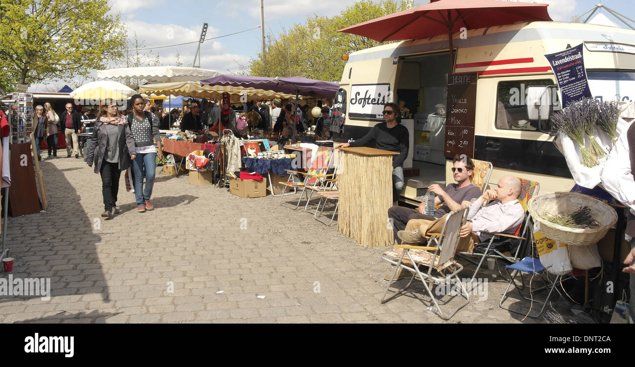 Sunny view to canopy market stalls people walking three men outside caravan selling ice-cream Mauerpark Flea Market Berlin & Sunny view to canopy market stalls people walking three men ...