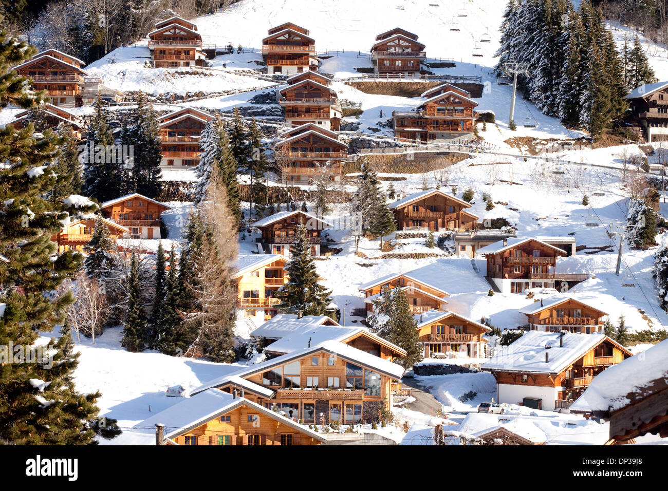 swiss ski chalets in winter in the skiing of morgins les stock photo royalty free